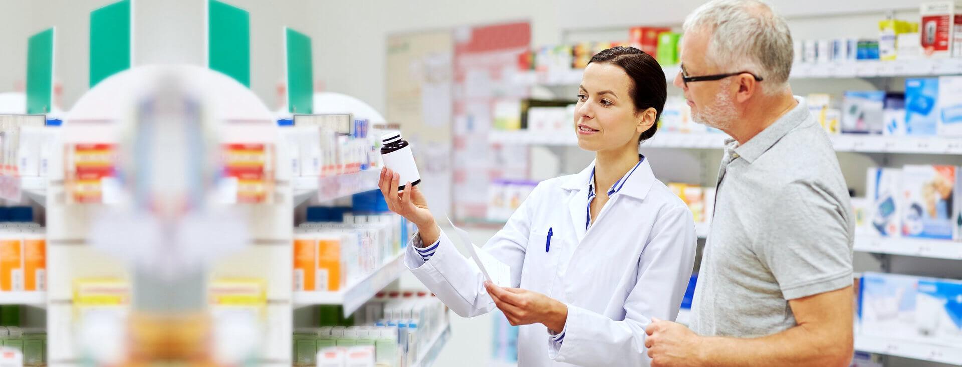 pharmacist assisting a senior man