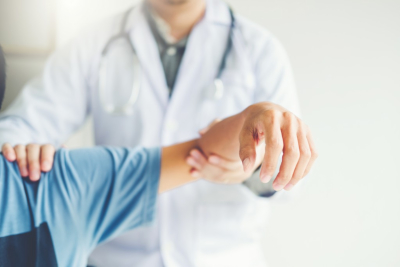 Doctor consulting with patient Shoulder problems