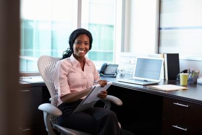 Portrait Of Female Doctor Working In Office