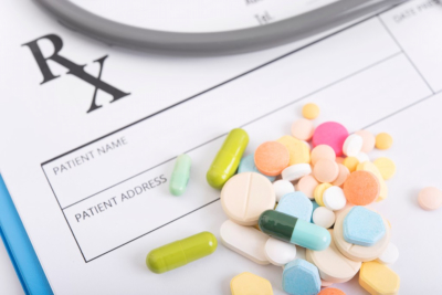 Pharmacy background on table. prescription paper with colorful medicine