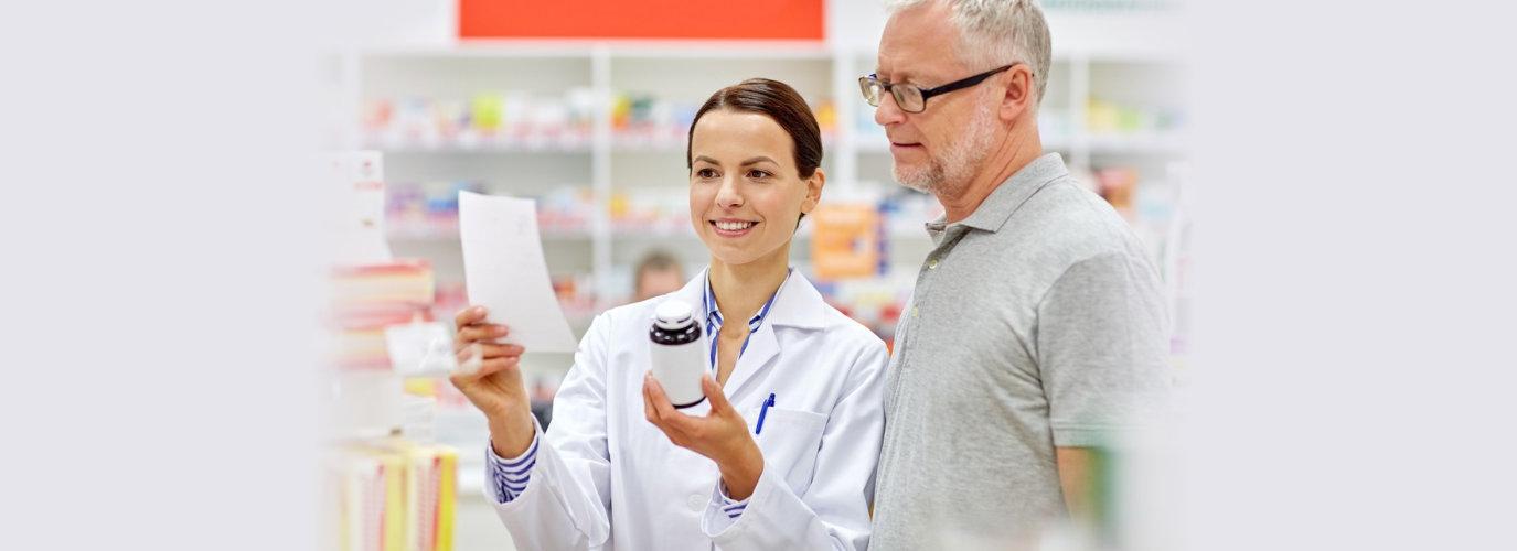 pharmacist showing senior medicine
