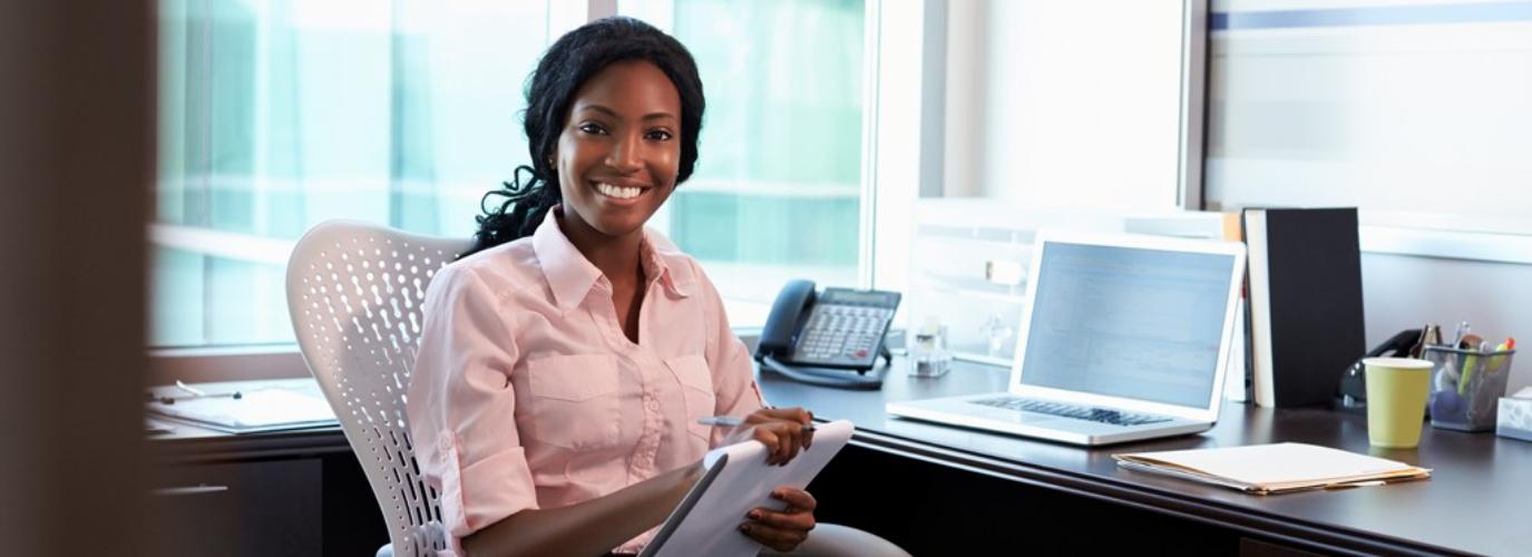 """Portrait Of Female Doctor Working In Office"