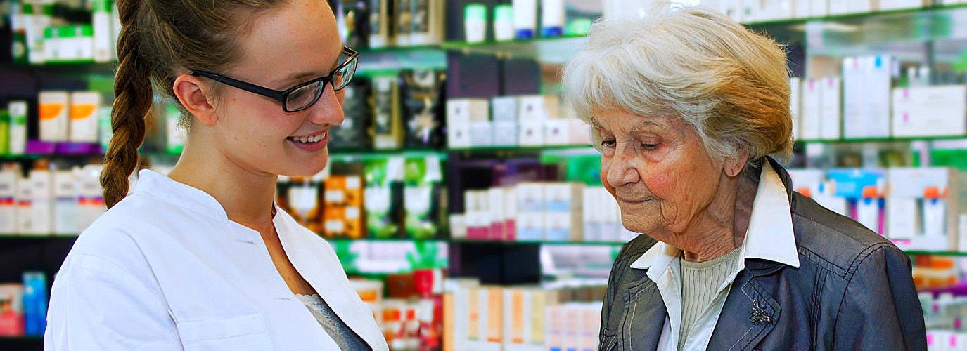 pharmacist talking to a senior woman